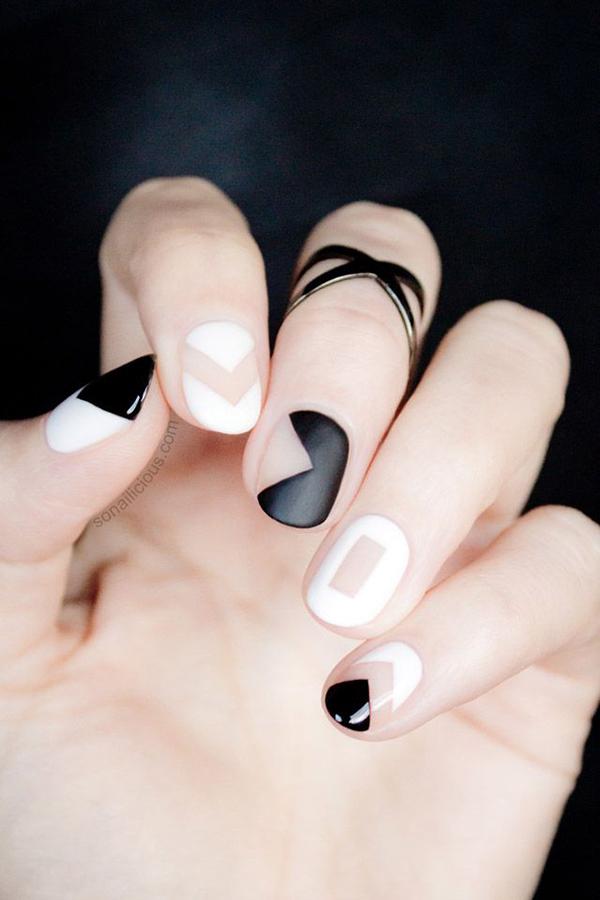 Black, white, negative space, and matte nail design